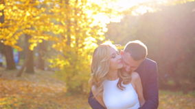 Beautiful young couple in the sunny autumn park stock video footage