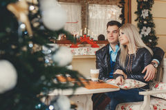 Beautiful young couple at a table in a cafe Stock Photo