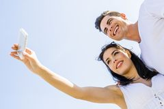 Beautiful  young couple taking a selfie on a summer day. Beautiful  young couple taking a self portrait on a summer day Stock Photography