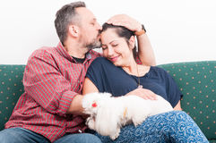 Beautiful young couple with their dog. In a moment full of affection as togetherness and love concept Royalty Free Stock Photos
