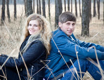 Beautiful young couple  together in forest Royalty Free Stock Images