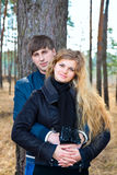 Beautiful young couple  together in forest Royalty Free Stock Image
