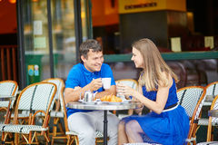 Beautiful young couple of tourists in Parisian street cafe Royalty Free Stock Image