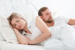 Sensual young couple together in bed. Happy couple in bedroom  on a white background. Stock Image
