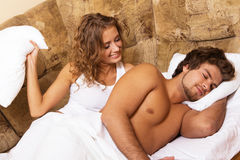 Beautiful young couple waking up. Home interior Stock Photo