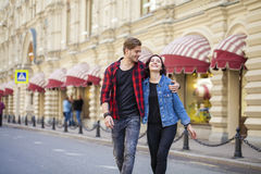 Beautiful young couple on a walk in the city Stock Images