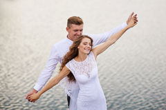 Beautiful young couple walking near the lake on the wedding day Royalty Free Stock Photo