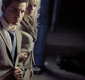 Beautiful young couple walking together in night city Stock Images