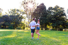 Beautiful young couple walking together in the park Stock Photo
