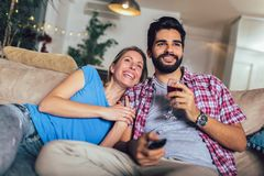 Young couple watching TV in living room royalty free stock photo