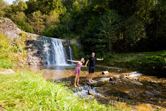 Beautiful young couple by waterfall Stock Image