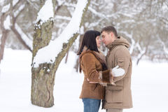 Beautiful young couple in winter park Royalty Free Stock Image