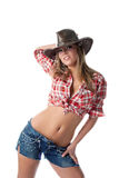 Beautiful young cowgirl stand with naked stomach Royalty Free Stock Photos