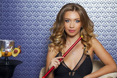 Beautiful Young Curly Blonde Woman Resting In The Hookah Room Royalty Free Stock Image