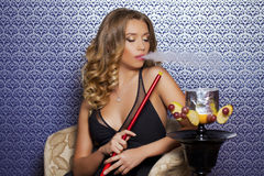 Beautiful Young Curly Blonde Woman Resting In The Hookah Room Royalty Free Stock Photo