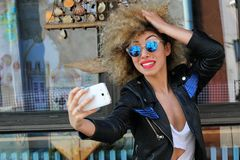 Beautiful young curly girl selfie. Attarctive happiness crazy fun selfi royalty free stock photos