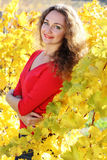 Beautiful young curly girl in yellow grape Royalty Free Stock Photography
