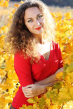 Beautiful young curly girl in yellow grape Stock Photography