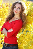 Beautiful young curly girl in yellow grape Stock Photos