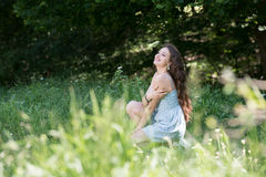 Beautiful young curly hair girl wear dot dress Royalty Free Stock Photography