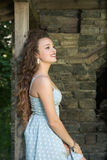 Beautiful young curly hair girl wear dot dress Royalty Free Stock Image