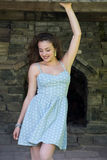 Beautiful young curly hair girl wear dot dress Stock Photos