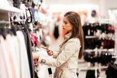 Beautiful woman shopping lingerie stock photography