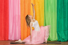 Beautiful young dancer spreads her arms Stock Photo