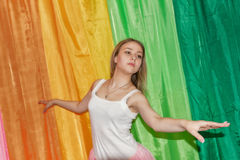 Beautiful young dancer spreads her arms Royalty Free Stock Image