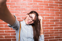 Beautiful young dark-haired girl in casual clothes and eyeglasses posing, Stock Images
