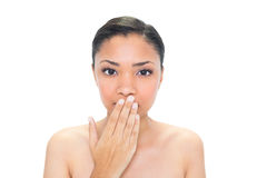 Beautiful young dark haired model covering her mouth Stock Photo