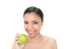 Beautiful young dark haired model holding a green apple Stock Photography