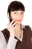 A beautiful young dark-haired woman talking on a mobile phone Stock Images