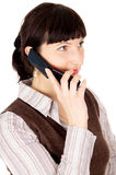 A beautiful young dark-haired woman talking on a mobile phone Stock Image