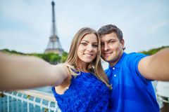 Beautiful young dating couple in Paris making selfie Royalty Free Stock Photography