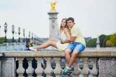 Beautiful young dating couple in Paris royalty free stock images
