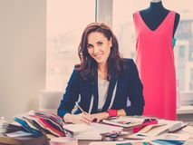 Beautiful young designer in her fashion atelier  showroom. Stock Photography