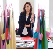 Beautiful young designer in her fashion atelier  showroom. Royalty Free Stock Photos
