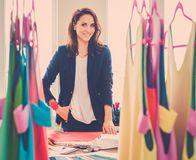 Beautiful young designer in her fashion atelier  showroom. Stock Photos