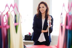 Beautiful young designer in her fashion atelier  showroom. Royalty Free Stock Image