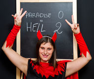 Beautiful young devil woman royalty free stock image