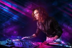 Young DJ playing on turntables with color light effects. Beautiful young Dj playing on turntables with color effects Stock Photos