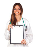 Beautiful young doctor holding a blank folder Royalty Free Stock Image