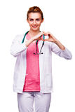Beautiful young doctor showing heart sign Royalty Free Stock Photography
