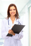 Beautiful young doctor with stethoscope Stock Image