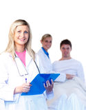 Beautiful young doctors with a patient Royalty Free Stock Photos
