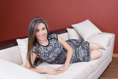 Beautiful young elegant girl wearing grey dress in Stock Image