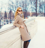 Beautiful young elegant woman wearing a coat jacket and sunglasses Royalty Free Stock Photography
