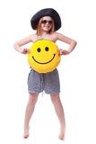 Beautiful young elementary age school girl with big yellow smile Royalty Free Stock Images