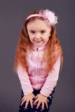 Beautiful young elementary age school girl with long curly red h Stock Photography